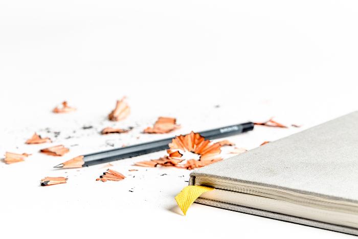 Bleistift und Notizbuch